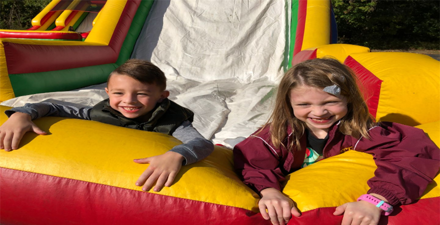 kids smiling in bounce house