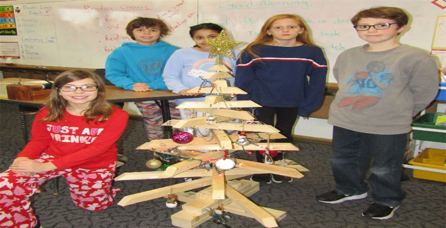 kids with wooden Christmas tree